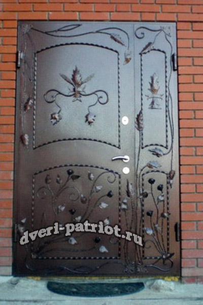декор из ковки на металлическую дверь